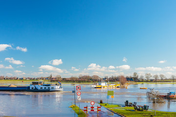 Flooded road in front of the Dutch river IJssel
