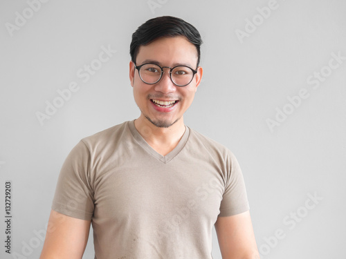 Asian man laughing