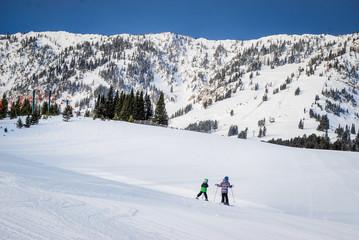 Children exploring a ski mountain in Montana.