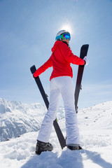 Beautiful brunette woman with ski