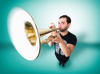 Funny man is playing trumpet