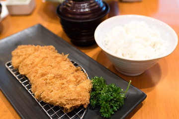 soft focus of japanese fried pork (tonkatsu) served with rice and tofu soup