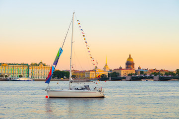 Yacht on Neva River, Hermitage, Admiralty and St Isaac cathedral, St Petersburg, Russia