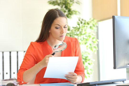 Businesswoman examining a contract meticulously