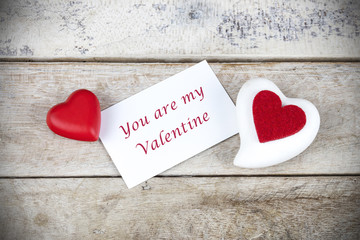 """Valentine greeting card on wooden table with text """" You are my Valentine"""""""