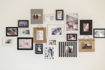 photos of the family in various photo frames Wall mural