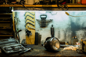 Motorcycle parts on the desktop in the garage
