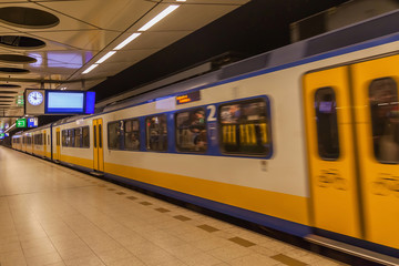 Train moving out from subway station in The Netherlands