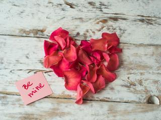 Be mine words written on paper, love card. Valentine's Day background, love postcard.