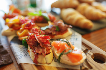 Classic Spanish tapas cooked for the visitors of the event on a wooden board.