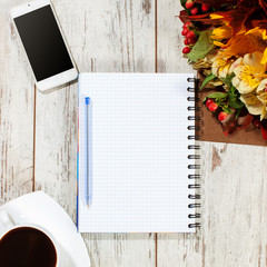 Notebook, phone and coffe for planning