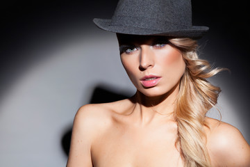 Portrait of a beautiful woman in hat. Retro fashion. Blond hair.