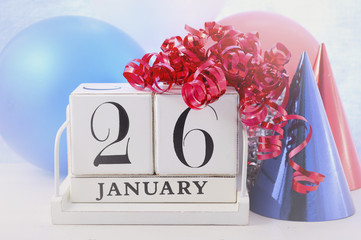 Happy Australia Day calendar with red, white and blue party decorations, with applied faded retro style filters.