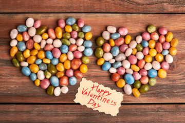 Valentine's Day card near sweets. Candies in shape of hearts. Make this day special.