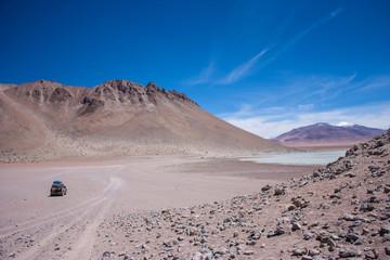 Bolivia Salar de Uyuni altiplano landscape volcano lake and desert remote offroad laguna colorada