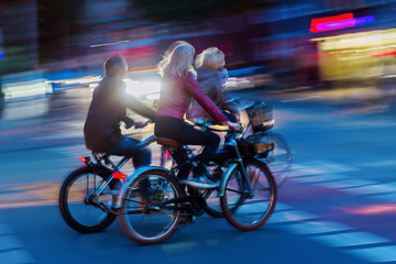 group of bicycle riders at night