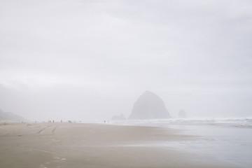 Haystacks of Canon Beach in the fog