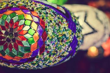Colorful blurry shiny background of illuminated beautiful lighting lamps, closeup view