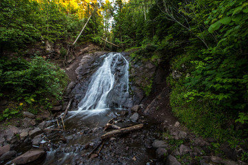 Michigan Roadside Waterfall. Jacobs Falls in the Keweenaw Peninsula is a popular roadside scenic stop on M-26 in the Upper Peninsula. Eagle Harbor, Michigan.