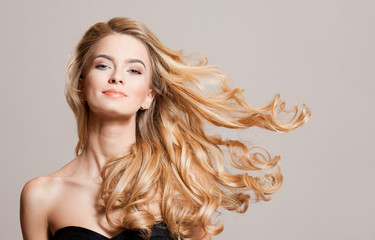 Blond beauty with healthy hair. Wall mural