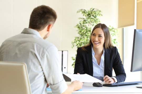 Man giving curriculum in a job interview