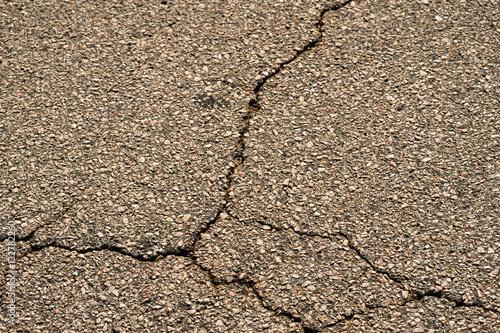 quotcracked asphalt road surface backgroundquot imagens e fotos