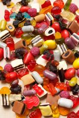 Gummy fruit marmelade candies on old paper background