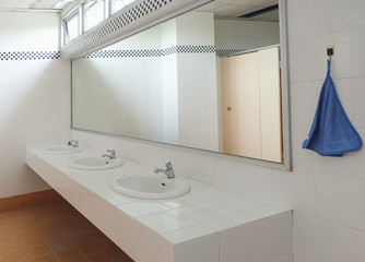 Bathroom at office.Handbasin and mirror in toilet