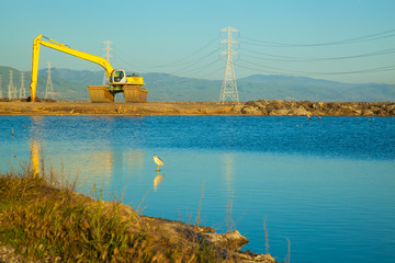 Excavator at San Francisco Bay salt ponds.