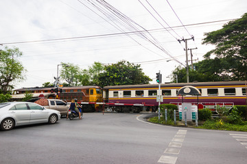 Bangkok Thailand  :  January 5, 2017  :- car waiting for a passing container train on a secured train crossing