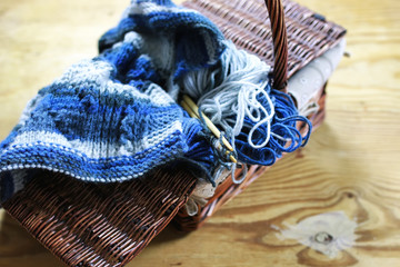 wool and knitting needles basket