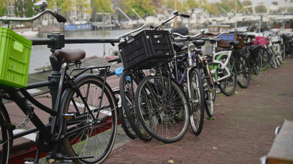 Center of Amsterdam - bicycles parking near amstel canal, the Netherlands