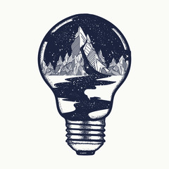 Mountains in a light bulb, tattoo. Symbol of a travel, tourism