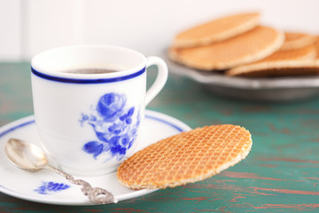 Cup of coffee with a Dutch stroopwafel cookie
