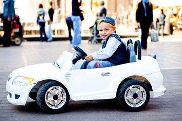 Baby, don't look at my like this! Little man looks shy driving h
