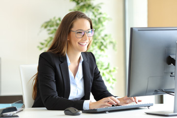 Businesswoman working wearing glasses