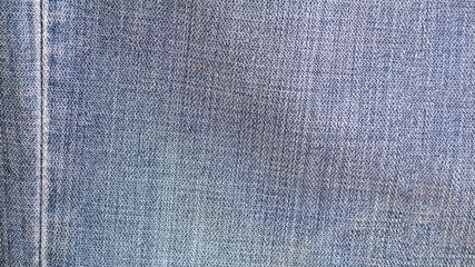 Denim jeans texture, denim jeans background with seam of jeans fashion design.