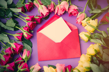 beautiful yellow and pink rose flowers and envelope