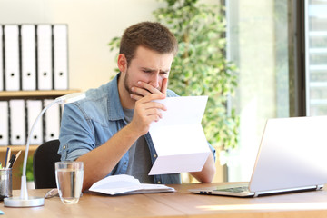 Worried entrepreneur reading a letter
