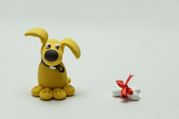 Dog a mongrel and a bone from plasticine