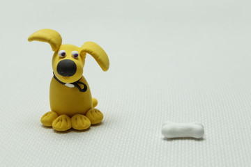 Dog and a bone from plasticine