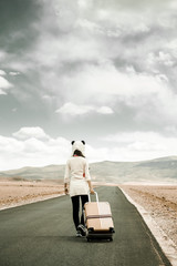 Girl traveling through the road