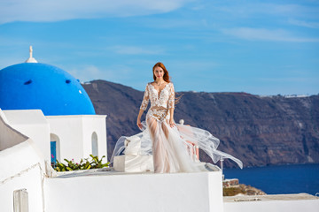 Beautiful young woman in white dress and island  Santorini