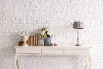 old white table in front of the brick wall decoration