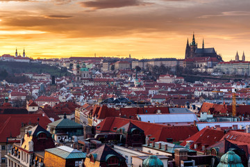 Old Town of Prague (Czech Republic) in sunset. Skyline with Old town and Castle (Hrad) of Prague in the background. Picture represents main landmarks of spectacular city.