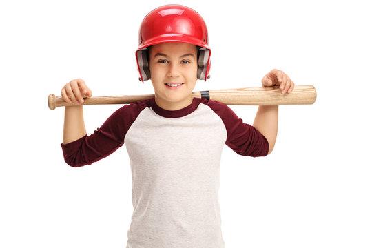 Joyful little boy posing with a baseball bat