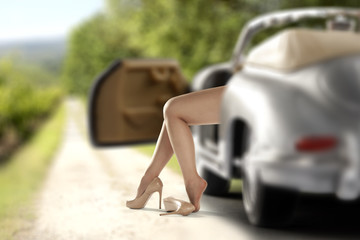 woman legs and car