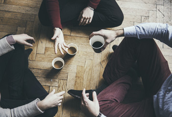 Socializng concept - friends taking a coffee and talking, hipster mood