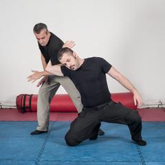 Kapap instructor demonstrates arm lock techniques