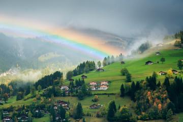 Alpine Landscape With Rainbow